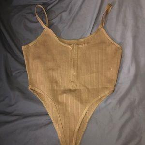 Beige, thong, zip up bodysuit.
